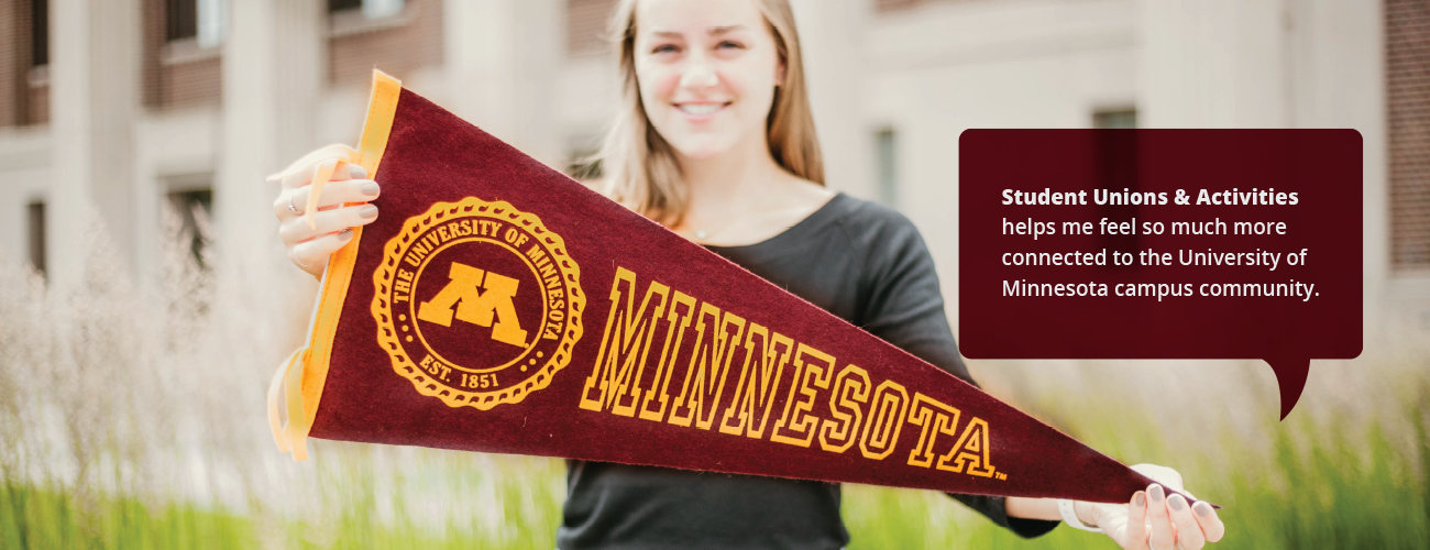 Student with a University of Minnesota pennant